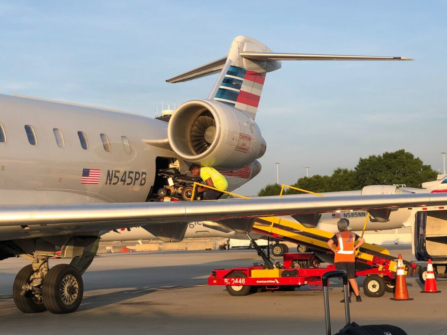Journalist and 'aviation geek' John Morris discovered a new cargo weight limit at American Airlines that effectively barred power wheelchair users. In the photo, AA staff are loading Morris deconstructed power wheelchair into the cargo hold of American Airlines CRJ-700 airplane.