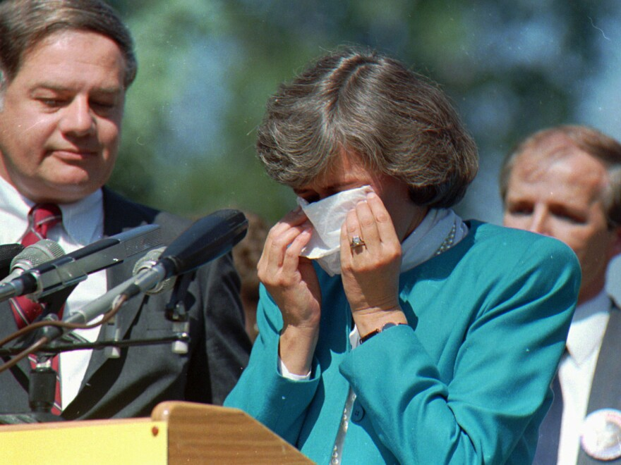 Former U.S. Rep. Patricia Schroeder wipes away tears after announcing she would not seek the 1988 Democratic presidential nomination at a news conference on Sept. 28, 1987, in Denver.