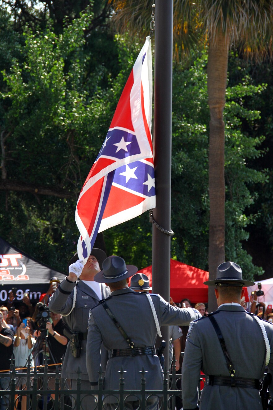 South Carolina State Police remove the Confederate flag from the Statehouse grounds.