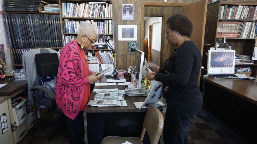Roanoke Tribune publisher Claudia Whitworth and longtime staffer Leslie Terry process newspapers in preparation for mailing.