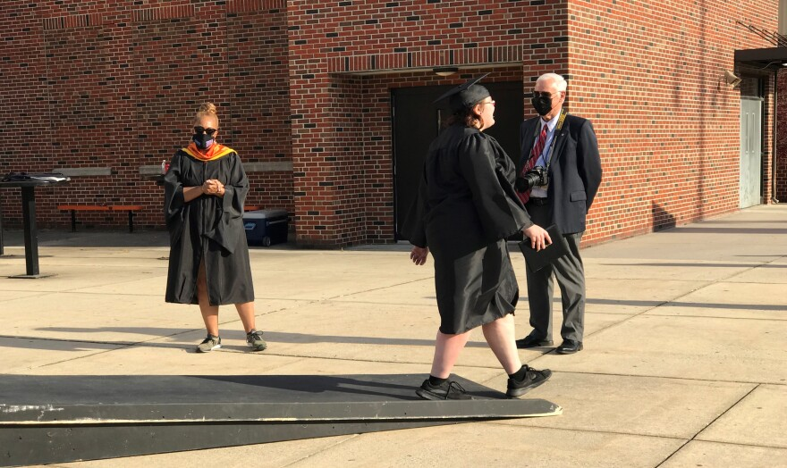 Some staff members at Martinsburg High School did wear face coverings during the drive-through graduation on May 26, 2020.