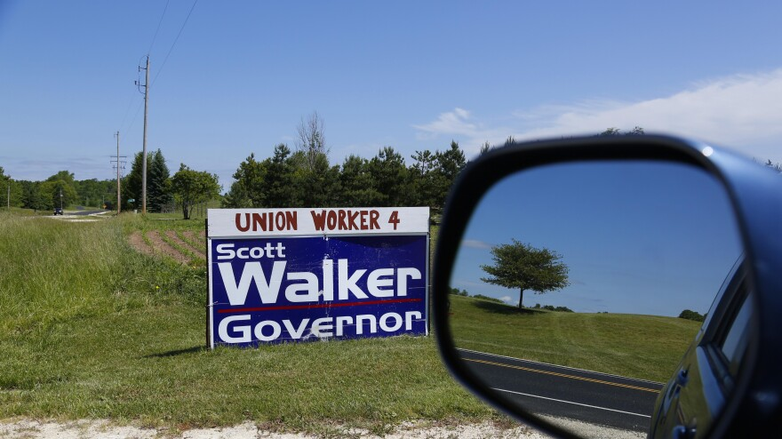 A sign along a county highway in Saukville, Wis. Exit polls showed 38 percent of voters with a labor union member in the family voted for Republican Gov. Scott Walker.