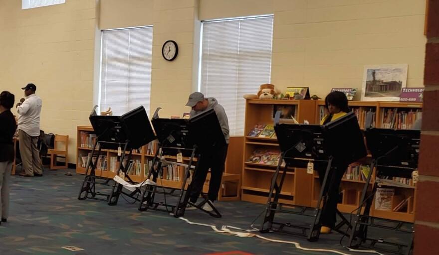 People vote at Croft Community School in Charlotte in November 2018..