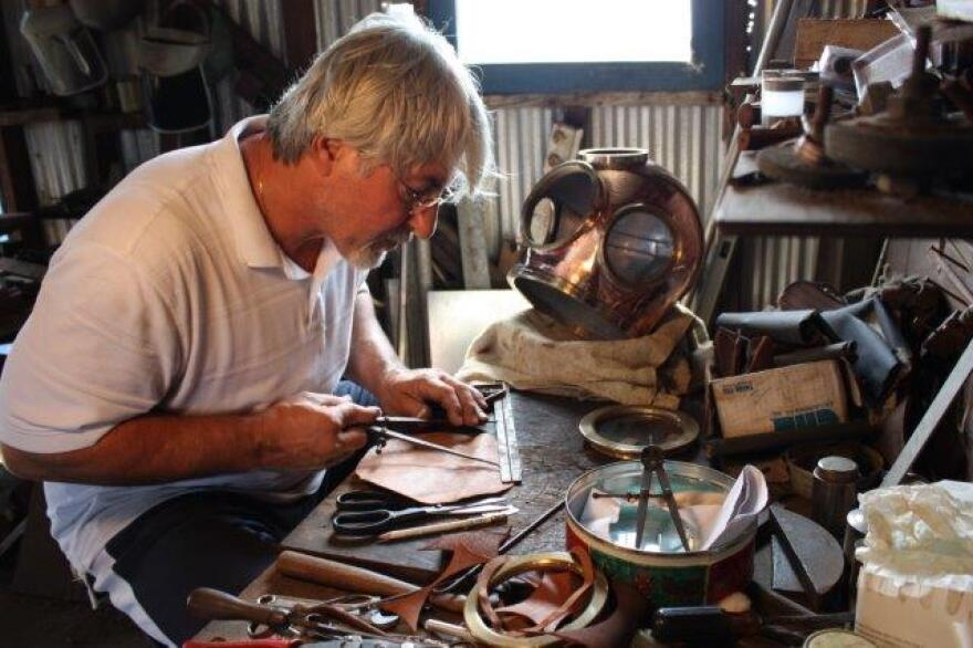 Nicholas Toth makes rings for a sponge diving helmet at his Tarpon Springs workshop in 2010.