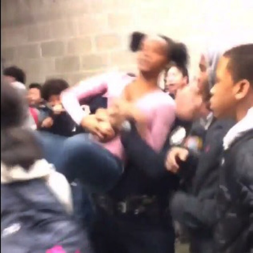 A screengrab of a video posted to Twitter showing a Rolesville High School student being slammed to the ground by a police officer.