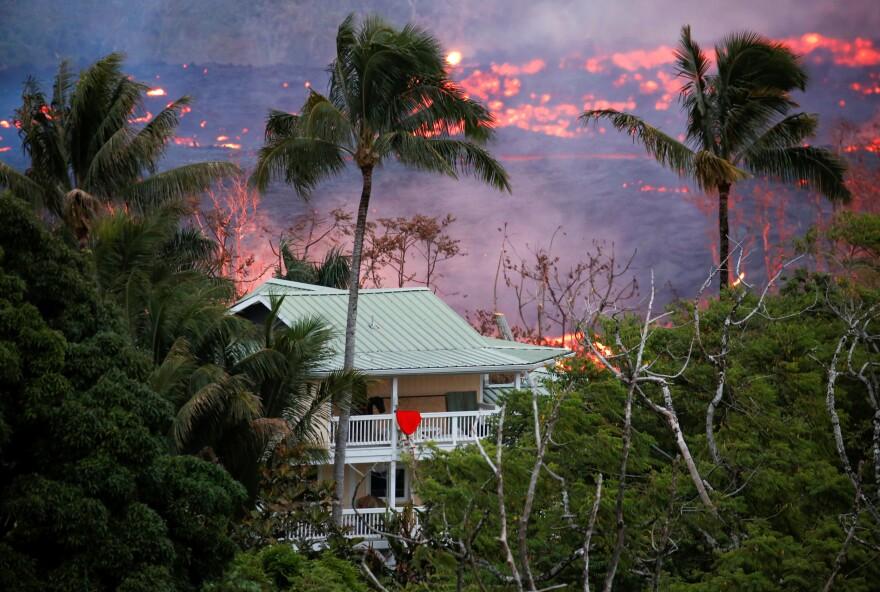 Lava flows near a house on the outskirts of Pahoa.