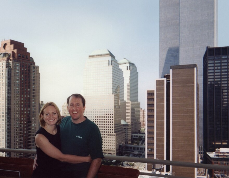 Christina and Brian Stanton pose on their Manhattan terrace with the Twin Towers in the background.