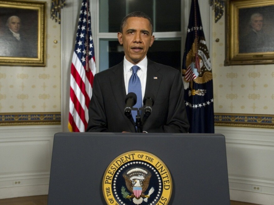 President Obama announced an agreement Friday night to cut the budget and avoid a partial shutdown of the federal government.
