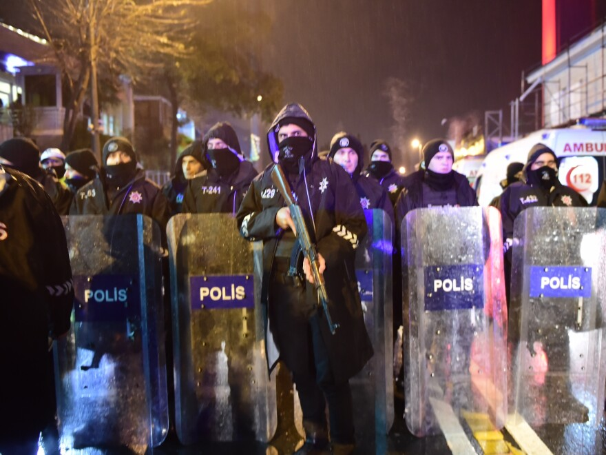 Turkish anti-riot police officers stand guard at the site of an armed attack on Sunday in Istanbul.