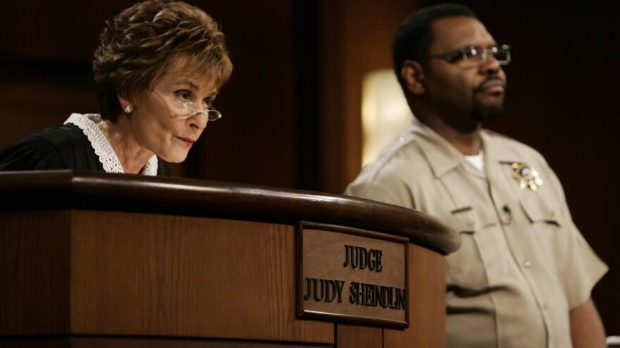 Judge Judy Sheindlin, seen here in 2006, presides over a case as bailiff Petri Hawkins Byrd listens.