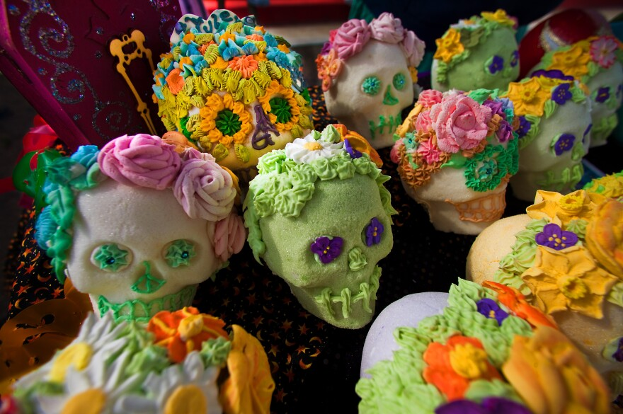 Elaborately decorated skulls are crafted from pure sugar and given to friends as gifts. The colorful designs represent the vitality of life and individual personality.
