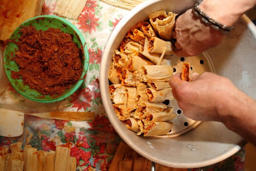 Pork tamales are assembled before they are steamed. Tamale-making is labor intensive, one reason why the bundles of masa tend to be reserved for special occasions.