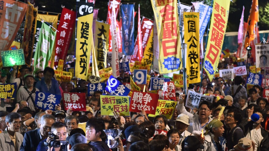 Demonstrators rally against Japanese Prime Minister Shinzo Abe's controversial security bills in front of the National Diet in Tokyo in September. The bills, which passed, will allow Japan to send its troops overseas for the first time since World War II. However, the likelihood of Japanese involvement in a foreign war appears quite small.