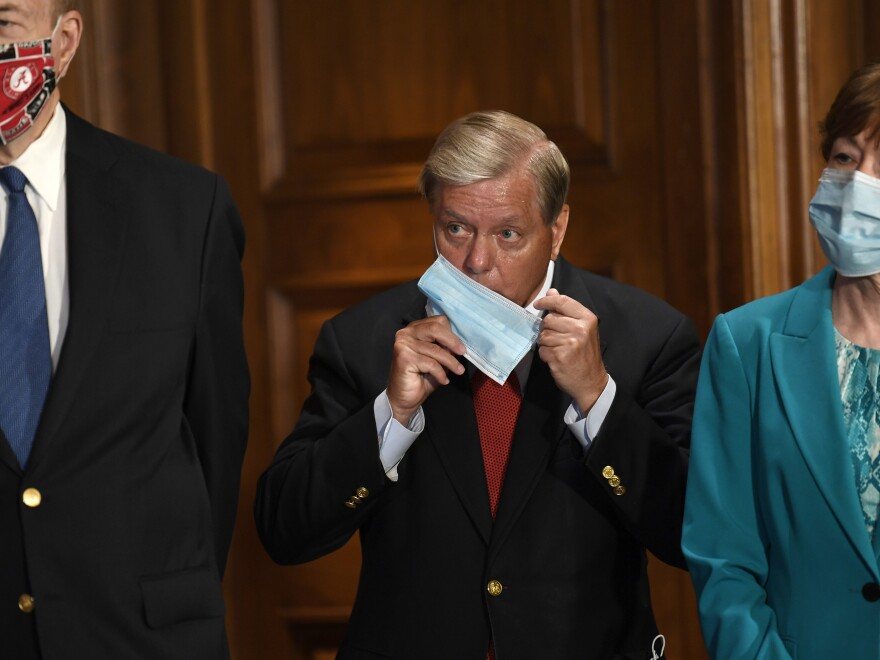Sen. Richard Shelby, R-Ala., left, Sen. Lindsey Graham, R-S.C., center, and Sen. Susan Collins, R-Maine, at a news conference last month. Graham is re-investigating the Russia inquiry.