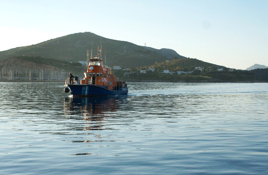 A crew from the Greek coast guard steers a search and rescue vessel to a port on the Aegean island of Leros after returning from an overnight patrol along the Greek-Turkish sea border.