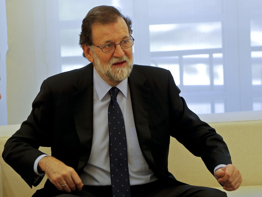 Spain's Prime Minister Mariano Rajoy begins a meeting with socialist opposition leader Pedro Sanchez at the Moncloa Palace in Madrid earlier this month. Rajoy has warned Catalonia not to act on an Oct. 1 independence referendum.