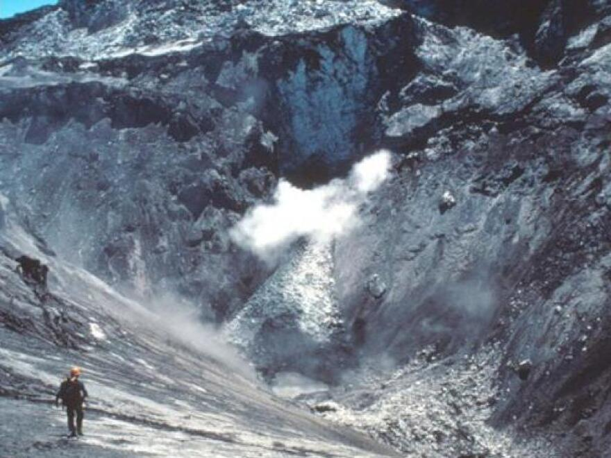 David Johnston enters a small crater at the summit of Mount St. Helens prior to the May 18, 1980, catastrophic collapse and eruption.