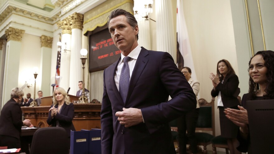 Calif. Gov. Gavin Newsom receives applause after delivering his first State of the State address. In that address he said he planned to scale back California's high-speed rail project and focus immediately on building 171 miles of track in central California.