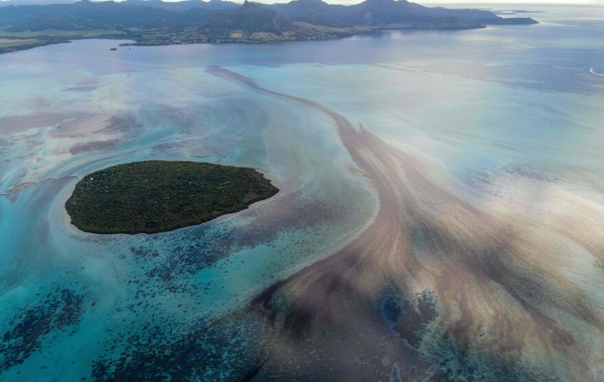 A large patch of leaked oil travels on ocean currents near the Pointe d'Esny in Mauritius on Saturday. The worsening oil spill is polluting the island nation's famous reefs, lagoons and oceans.