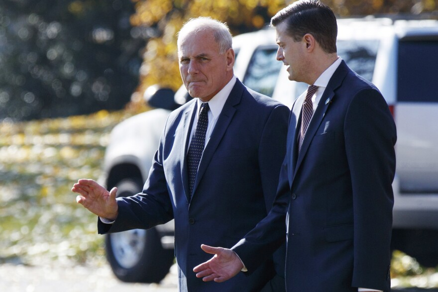 In this Nov. 29, 2017 file photo, White House Chief of Staff John Kelly, left, walks with White House staff secretary Rob Porter to board Marine One on the South Lawn of the White House in Washington. (AP Photo/Evan Vucci)