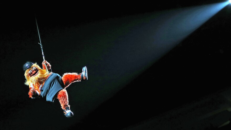 "Even rappelling from the rafters of the Philadelphia Flyers' arena, swinging to the tender tuneful power of Miley Cyrus' ""Wrecking Ball,"" Gritty can see you. He can see your soul."