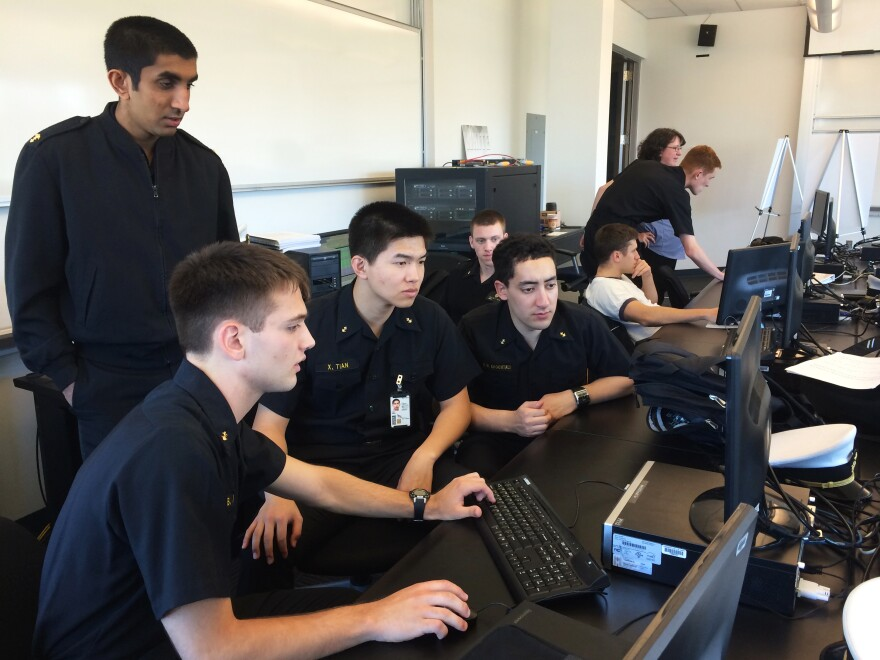 U.S. Naval Academy midshipmen taking part in the cyber exercise check to see if their computer network has been hacked by the NSA's red-cell team.