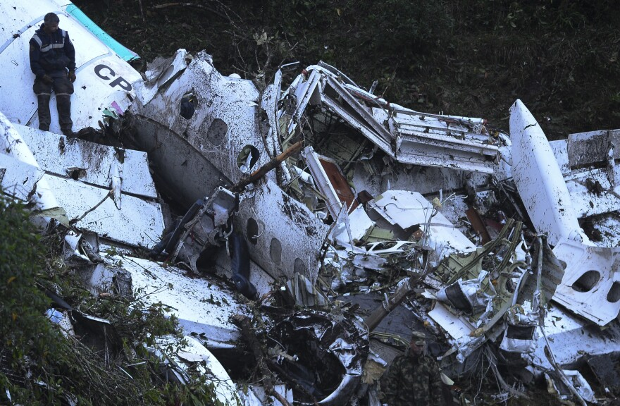 Rescue teams work on Tuesday to recover bodies from the wreckage of the LaMia charter plane that crashed in the mountains in Colombia late Monday, killing 71 people, officials say.