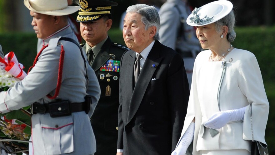 Emperor Akihito, seen here with Empress Michiko during a state visit to the Philippines last year, could be allowed to abdicate if Japan's legislature changes the law governing the throne.