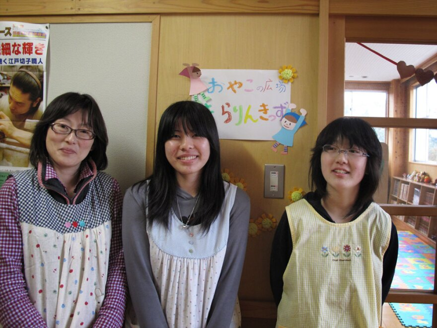Masako Ito (from left), 15-year-old Mai Kanno and Ito's daughter Shiori stand outside a  makeshift day care center they have set up in the library of Rikuzentakata Daiichi  Middle School. Masako Ito is trying to give both children and parents a place  to find comfort after the disaster.