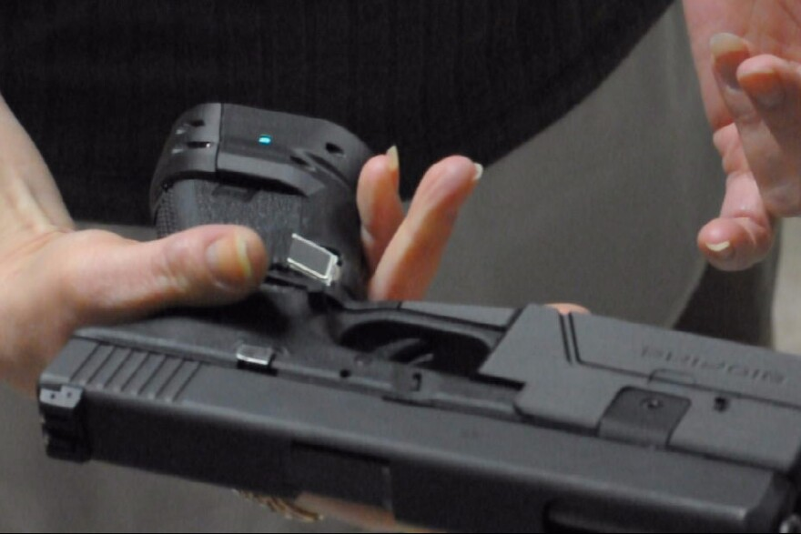 A prototype of The Biofire, a fingerprint-enabled 9 mm smart gun. Developers hope eventually to build the technology into it so it will  look no different than a typical handgun.