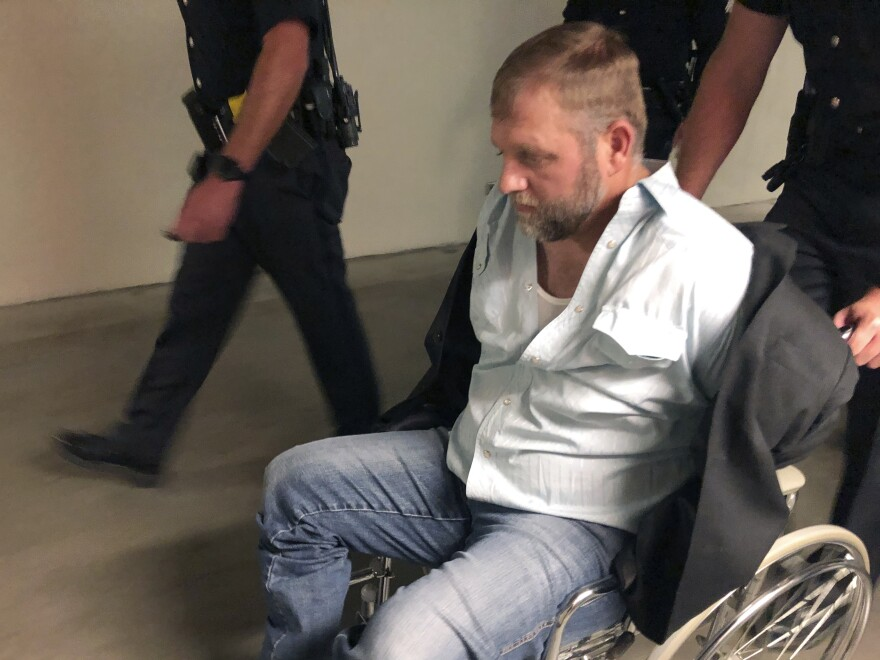 Anti-government activist Ammon Bundy is wheeled from the Idaho Statehouse in Boise, on Aug. 26, 2020. It was his second arrest for trespassing in two days.