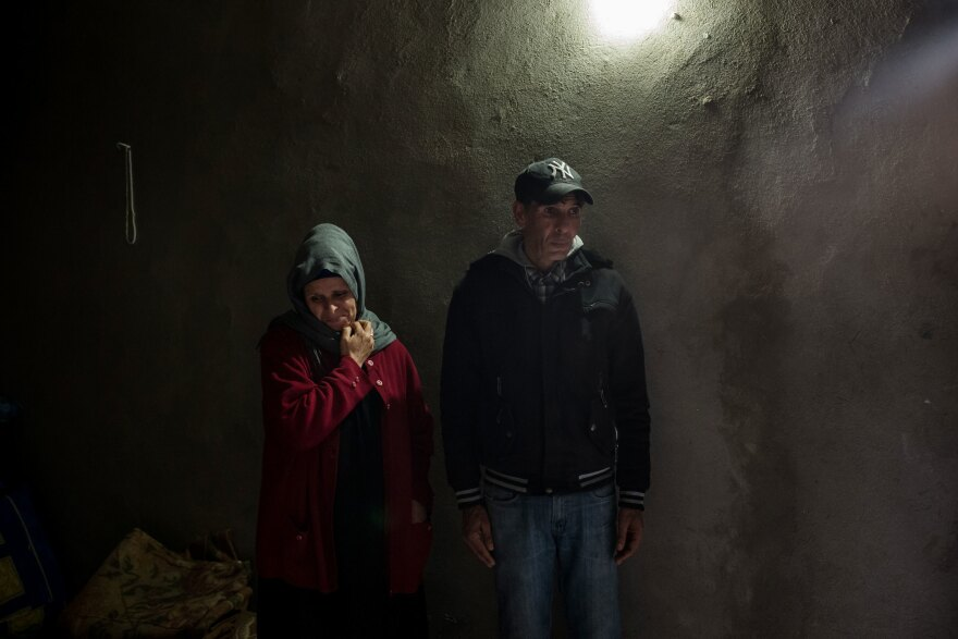 The parents of Abdelwaheb Hablani, Fouzia Araissi (left) and Jilani Hablani, stand in their home in Jelma.