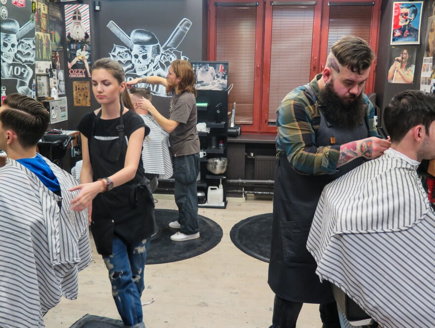 In Moscow, young people who never knew the conformism of the Soviet Union are developing their own styles. Artemy Zolotarevsky, right, cuts a customer's hair at Pomades, one of several new men's salons that have opened recently in the Russian capital.