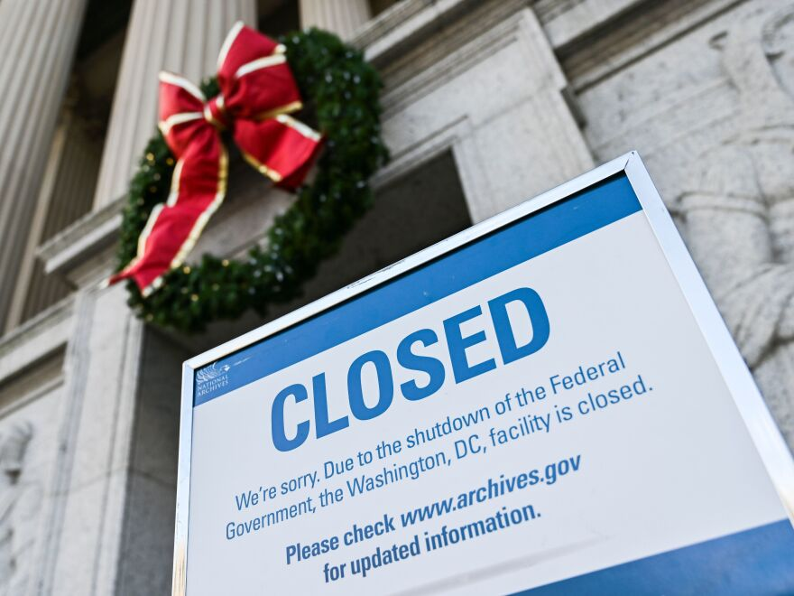 A sign outside the National Archives in Washington, D.C. informs visitors on Dec. 22, 2018 that the building is closed due to the ongoing government shutdown.