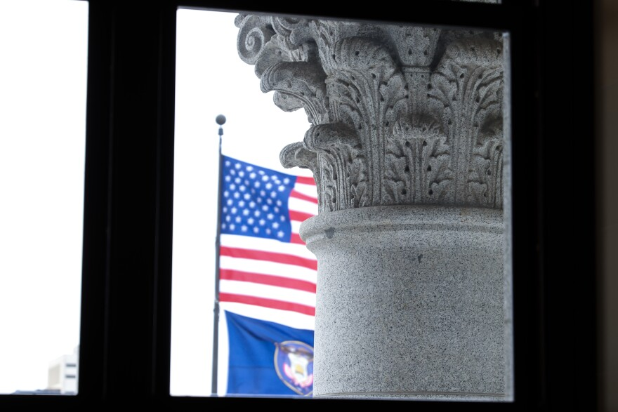 Photo of flags through capitol window.