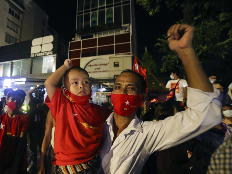 Supporters gather in front of Aung San Suu Kyi's National League for Democracy headquarters on Sunday, in Yangon, Myanmar.