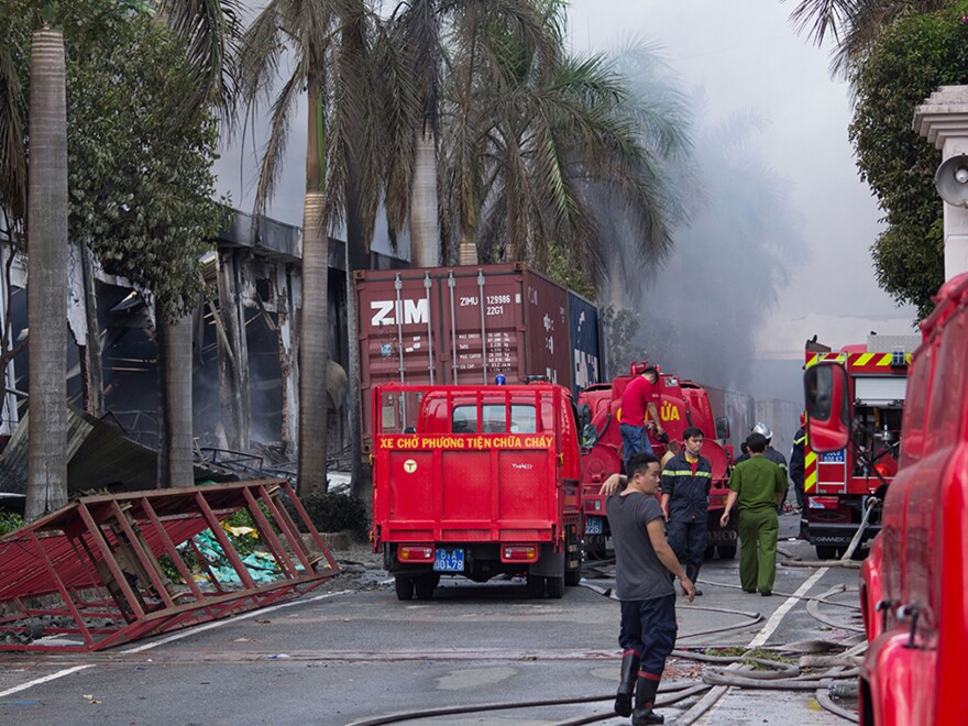 A Taiwanese bicycle factory in Ho Chi Minh City burns after mobs angered over Chinese moves in the South China Sea mistakenly targeted the facility, thinking it was Chinese owned.