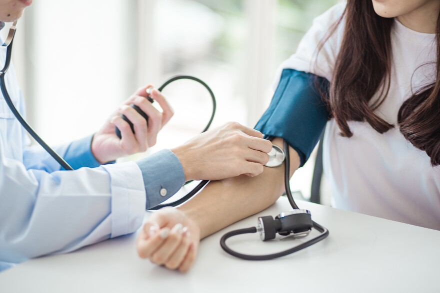 Stock image of a blood pressure screening