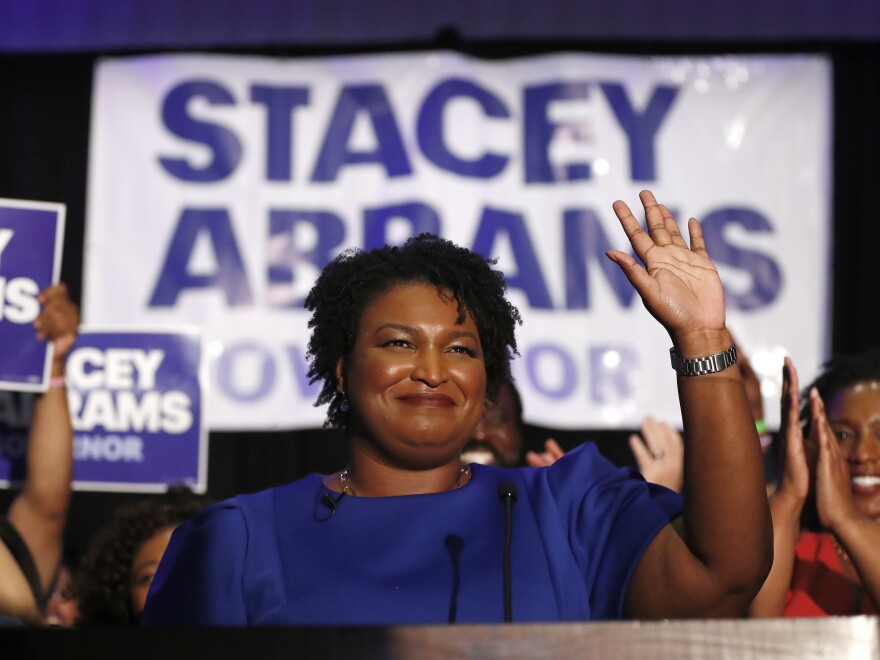 Democratic candidate for Georgia Governor Stacey Abrams waves to supporters on Tuesday after speaking at an election night watch party in Atlanta.