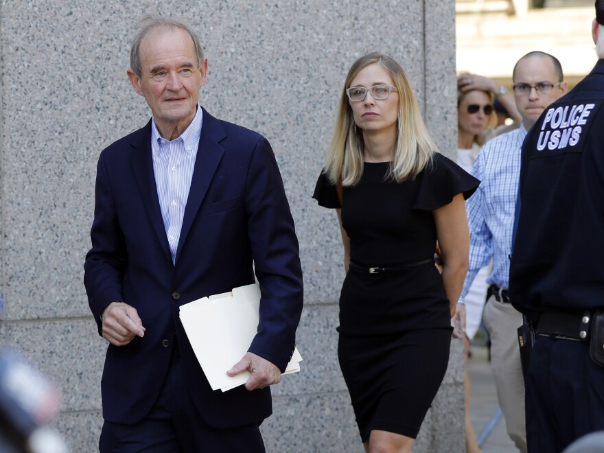 Attorney David Boies (left) and Annie Farmer, one of Epstein's accusers, walk to a news conference outside federal court in New York on July 15.
