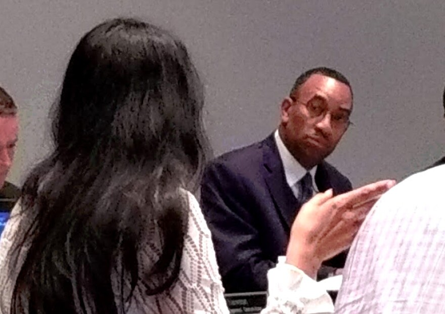 """City Council Economic Development Committee chair James """"Smuggie"""" Mitchell listens to council member Dimple Ajmera during Thursday's meeting about Eastland Mall."""