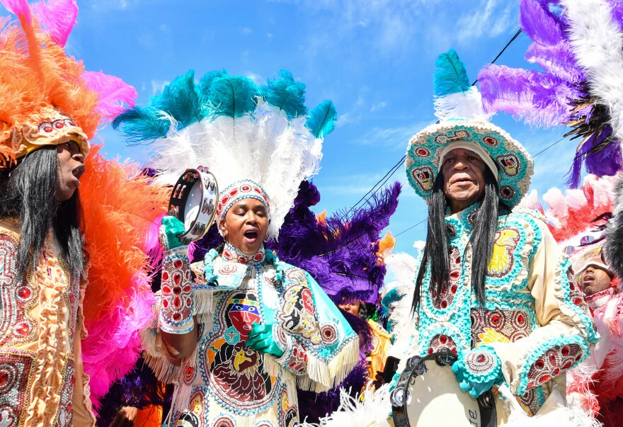 Mardi Gras Indian Big Chief Monk Boudreaux (right) and members of his Golden Eagles tribe in March 2019 in New Orleans.