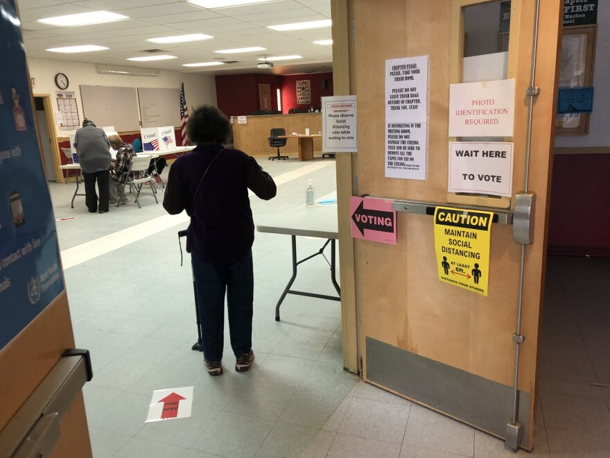 A Navajo woman waits to fill out her ballot at a polling place.