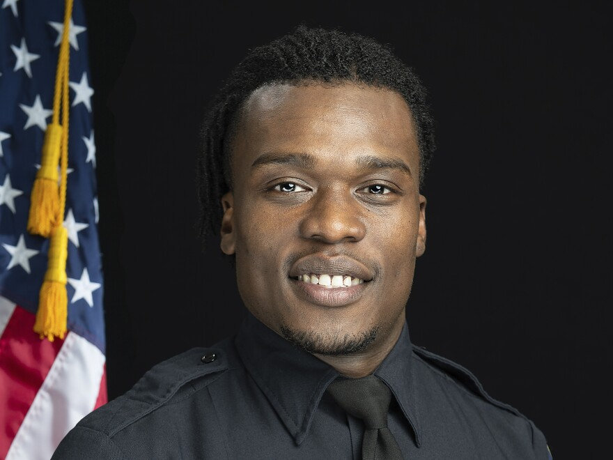 This undated photo from the Wauwatosa, Wisc., Police Department shows officer Joseph Mensah. He has fatally shot three people in the line of duty since 2015 and is resigning from the department Nov. 30.