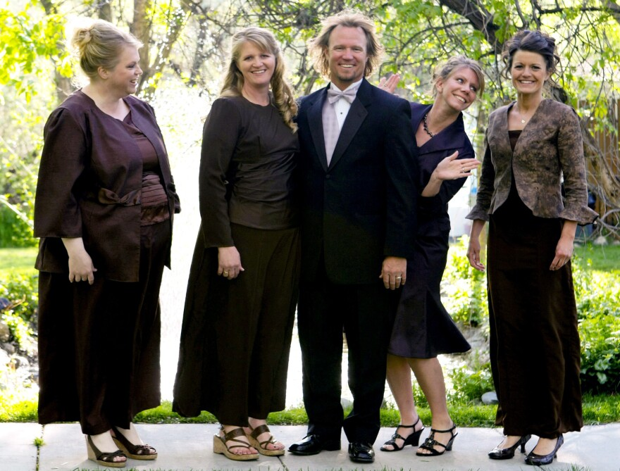 Kody Brown poses with his wives (from left) Janelle, Christine, Meri and Robyn in a promotional photo for TLC's reality TV show <em>Sister Wives.</em>