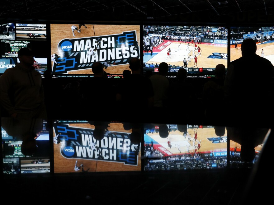 People watch coverage of the NCAA college basketball tournament at the Westgate SuperBook on March 15 in Las Vegas. Several states are expected to allow sports gaming after Monday's Supreme Court ruling.