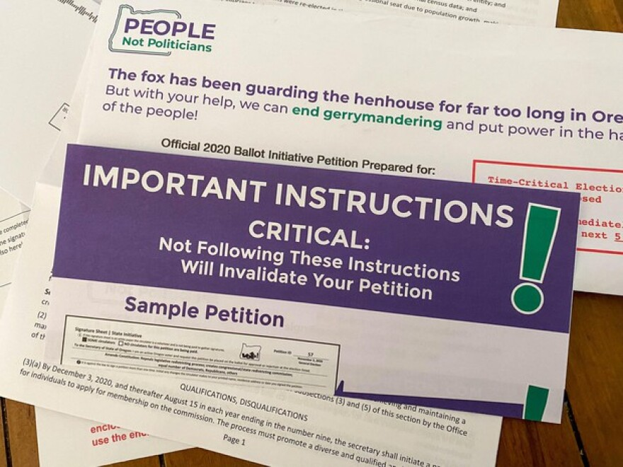 This package was sent to a half-million Oregon households containing petitions for an initiative that would take congressional and legislative redistricting out of the hands of the Oregon Legislature.