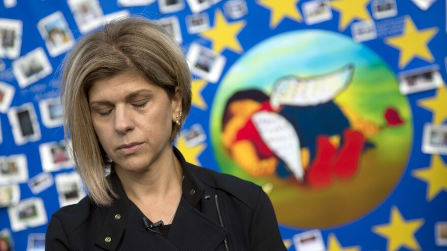 Tima Kurdi, seen here next to a painting of her late nephew, Alan Kurdi, says she has received official approval to welcome her brother and his family into her home in Canada.
