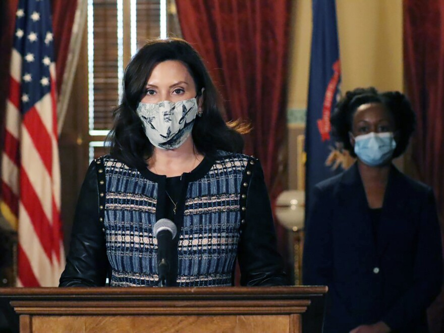 In a photo provided by the Michigan Office of the Governor, Gov. Gretchen Whitmer addresses the state during a speech in Lansing, Mich., on Nov. 5. The governor said she sent a letter to Republican lawmakers this week asking them to pass a bill to require residents wear masks in indoor places and crowded outdoor areas.