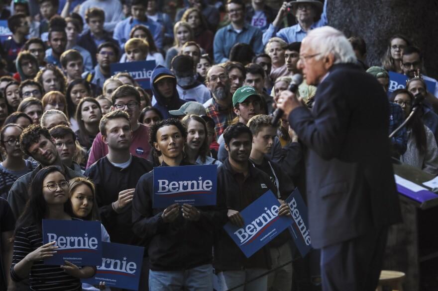 Students listen, as presidential candidate Bernie Sanders speaks at Dartmouth College in Hanover, N.H.